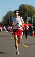 3 OCT. 2010 -- ST. CHARLES, Mo. -- Marathon winner Steve Werths (6832) covers the final yards to the finish line while competing in the Lewis & Clark Marathon and Half-Marathon in St. Charles, Mo. Sunday Oct. 3, 2010. Image © copyright 2010 Sid Hastings.