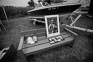 """A portrait of """"The Duke"""" and a boat are among seemingly infinite varities of things for sale by local residents during the annual """"50 Mile Yardsale"""", Saturday, July 20, 2016 along Route 90 in the Cayuga Lake region of the Finger Lakes, New York."""