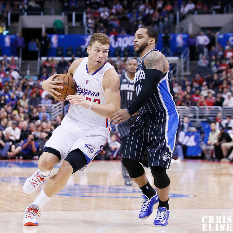 06 January 2014: Los Angeles Clippers power forward Blake Griffin (32) drives past Orlando Magic point guard Jameer Nelson (14) during the Los Angeles Clippers 101-81 victory over the Orlando Magic at the Staples Center, Los Angeles, California, USA.