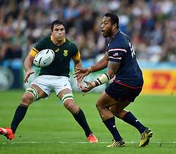 Andrew Suniula of the USA passes the ball - Mandatory byline: Patrick Khachfe/JMP - 07966 386802 - 07/10/2015 - RUGBY UNION - The Stadium, Queen Elizabeth Olympic Park - London, England - South Africa v USA - Rugby World Cup 2015 Pool B.
