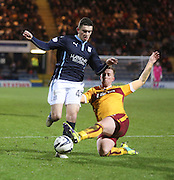 Dundee's Alex Harris evades the challenge of Motherwell's Craig Reid -  Dundee v Motherwell, SPFL Premiership at Dens Park <br /> <br /> <br />  - &copy; David Young - www.davidyoungphoto.co.uk - email: davidyoungphoto@gmail.com