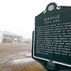 A plaque for the city of Leeville, Louisiana, U.S., on Monday, December 18, 2017.   Louisiana is preparing recommendations through projects with LA Safe for emptying out coastal areas that are unprotected by levees and will be impacted by sea level rise in the coming years. Photographer: Derick E. Hingle/Bloomberg