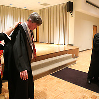 John White gets a little help putting on his judges robe from his wife following his oath of office for the Circuit Court Judgeship on Friday in Booneville.