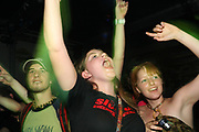 Girls enjoying themselves, Skindred gig, Porth, Wales 2006
