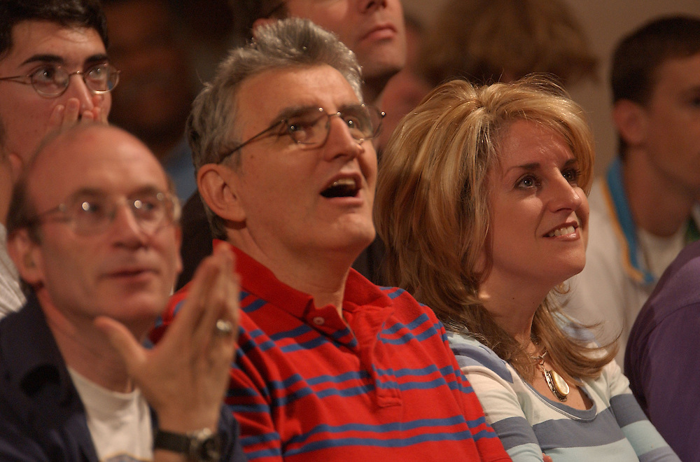 Division one SCRABBLE players, Jerry Lerman, left, Zev Kaufman, center, and Robin Pollock-Daniel, right, react to a play seen on closed circuit television at the Reno Hilton during the championship game of the 2005 National SCRABBLE Championship, Wednesday, Aug. 24, 2005. The finals featured Panupol Sujjayakorn, 21, of Bangkock, Thailand, and Dave Wiegand, 31, Portland, Ore. (Photo by David Calvert).