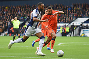 West Bromwich Albion midfielder Matt Phillips (10) on the attack tracked by Millwall defender James Meredith (3) during the EFL Sky Bet Championship match between West Bromwich Albion and Millwall at The Hawthorns, West Bromwich, England on 22 September 2018.
