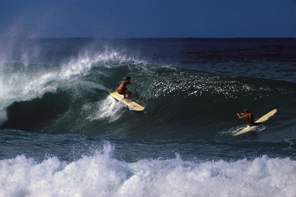 David Nuuhiwa and Jock Southerland enjoy the moment at Pipeline in the winter of 1966. About 20 of us just watched from the beach for about 30 min before anybody else went out, we were in awe.