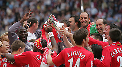 CARDIFF, WALES - SATURDAY, MAY 13th, 2006: Liverpool's players celebrate with the FA Cup after beating West Ham United on penalties during the FA Cup Final at the Millennium Stadium. (Pic by David Davies/Pool/Propaganda)