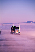 Alaska. Truck driver transporting oil drilling supplies to the North Slope oil fields in Prudhoe Bay.