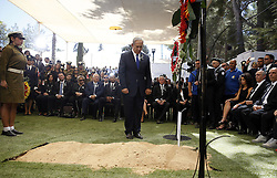 September 30, 2016 - Jerusalem, ISRAEL - Israeli Prime Minister Benjamin Netanyahu observes a moment of silence after laying a wreath near the grave of former Israeli President Shimon Peres during the burial ceremony at Mount Herzl Cemetery in Jerusalem September 30, 2016. Shimon Peres was being laid to rest on Friday in a ceremony attended by thousands of admirers and dozens of international dignitaries √¢'Ǩ≈°√جø¬Ω√جø¬Ω√É¬Æ in a final tribute to a man who personified the history of Israel during a remarkable seven-decade political career and who came to be seen by many as a visionary and symbol of hopes of Mideast peace. (Credit Image: © Prensa Internacional via ZUMA Wire)