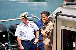 Capt. Robert Warren, Sector San Juan commander and Congresswoman Stacey Plaskett.  Coast Guard Boat Forces in the US Virgin Islands unveil two of the four 33-Special Purpose Craft Law-Enforcement (SPC-LEs) Boats that will be stationed in St. Thomas.   The SPC-LE's are specially built for counter-drug and migrant missions while patroling the border.  © Aisha-Zakiya Boyd