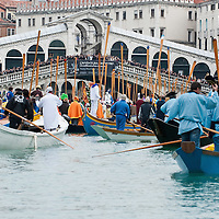 VENICE, ITALY - FEBRUARY 20:  Boats from from several rawing association reach Rialto Bridge and sail along the Grand Canal during the Venetian Feast on February 20, 2011 in Venice, Italy. During the Venetian Feast a traditional water parade sails from San Marco along the Canal Grande to the  district of Cannaregio where there the crowd waits for the Svolo della Pantegana (flight of the mouse).