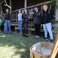 """Mooreville Elementary School student Stormie Williams, 14, left, tries her hand at """"Corn Cob"""" darts atthe annual Dogtrot hertiage festival held at the Oren Dunn Museum in Tupelo."""