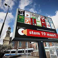 Nederland: Amsterdam; 21 februari 2014.<br /> Verkiezingsbord aan het Waterlooplein in aanloop naar de Gemeenteraadsverkiezingen op 19 maart.<br /> Foto:Jean-Pierre Jans