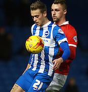 Brighton striker James Wilson shields the ball from Charlton Athletic defender Patrick Bauer during the Sky Bet Championship match between Brighton and Hove Albion and Charlton Athletic at the American Express Community Stadium, Brighton and Hove, England on 5 December 2015. Photo by Bennett Dean.