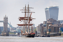 "© Licensed to London News Pictures. 23/05/2018. London, UK. The 107 year old tall ship, ""Eye of the Wind"" sails on the River Thames in front of the Leadenhall Building skyscraper and Tower Bridge during a London visit to join celebrations to mark forty years since the start of Operation Drake - a two year round the world expedition, of which Eye Of The Wind was the flagship. One of the last traditional sailing ships left, Eye of the Wind was originally built in Germany in 1911 as a Schooner but was given a new lease of life in 1973 when she was bought by Anthony ""Tiger"" Timbs, an Englishman from greater London. A group of enthusiastic ship lovers began to rig the vessel as a brigantine and her full restoration at a shipard in Faversham, Kent took nearly four years to complete. Photo credit: Vickie Flores/LNP"