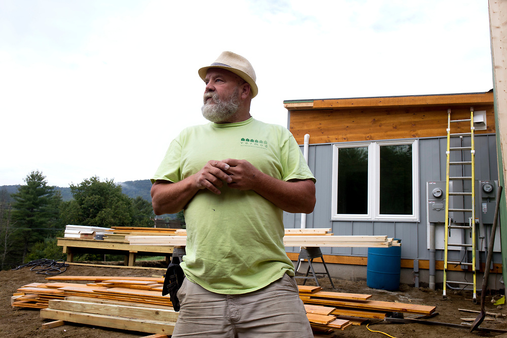 Vermod Homes owner Steve Davis speaks with the construction crew foreman on the job site at one of Vermod's modular home installations in Woodstock, Vt., on Aug. 30, 2017. The three-piece 1,500 square-foot home was built in VerMod's facility in Wilder, Vt., and put together on-site. (Photo by Geoff Hansen)