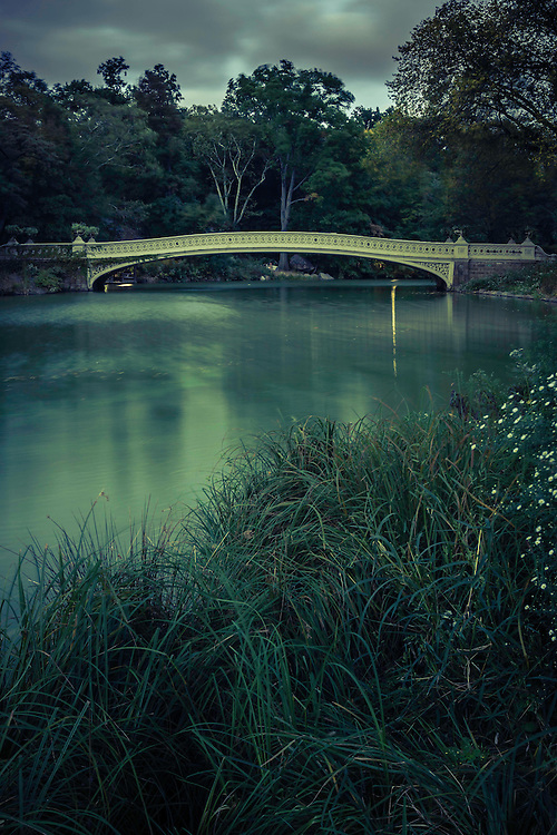 The Bow Bridge, a popular tourist spot, in Central Park on a cool Fall evening.