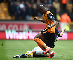 Millwall's Mark Beevers tackles Wolves' Benik Afobe - Photo mandatory by-line: Paul Knight/JMP - Mobile: 07966 386802 - 02/05/2015 - SPORT - Football - Wolverhampton - Molineux Stadium - Wolverhampton Wanderers v Millwall - Sky Bet Championship