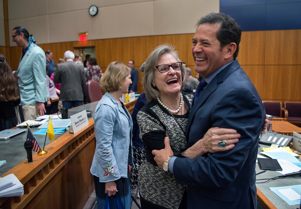 em031817a/a/Sen Pres Pro Temp Mary Kay Papen, D-Las Cruces, left, and Lt. Gov. John Sanchez hug after the end of the 2017 Legislative Session at the Roundhouse in Santa Fe, Saturday March 18, 2017. (Eddie Moore/Albuquerque Journal
