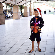 "Akha child wearing a Santa Claus hat at the premises of the NGO ""Children of the Golden Triangle"", in Chiang Rai province"