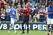 Sheffield United striker Leon Clarke (9) shows his ripped shirt to the referee Simon Hooper not in picture during the EFL Sky Bet Championship match between Sheffield Wednesday and Sheffield Utd at Hillsborough, Sheffield, England on 24 September 2017. Photo by Phil Duncan.