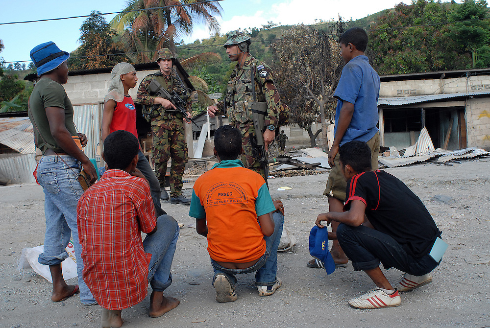 New Zealand Peacekeepers check locals for weapons - Becora Dili East Timor. Becora was badly affected by gang violence and ethnic tension between those from Western areas of East Timor and the East. 020606