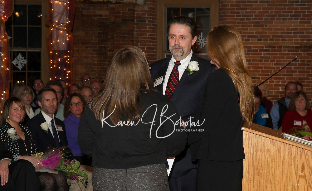 Mayor Edward Engler is sworn in by city clerk Mary Clerk with his daughter Laura during the inauguration ceremony at the Belknap Mill Monday evening.  (Karen Bobotas/for the Laconia Daily Sun)