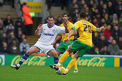 NORWICH, WALES - Saturday, November 14, 2009: Tranmere Rovers' Paul McLaren stretches out a leg in a attempt to try and stop Norwich City's Darel Russell run during the League One match at Carrow Road. (Pic by David Rawcliffe/Propaganda)