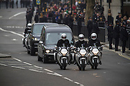 The funeral cortege with the coffin containing Margaret Thatcher driving along Whitehall, towards Trafalgar Square, London. The funeral of Baroness Thatcher of Kesteven took place at St. Paul's Cathedral in central London following a procession though the city with full military honours. Margaret Thatcher was Britain's first woman Prime Minister, from her election in 1979 until she resigned in 1990, she died on April 9, 2013.