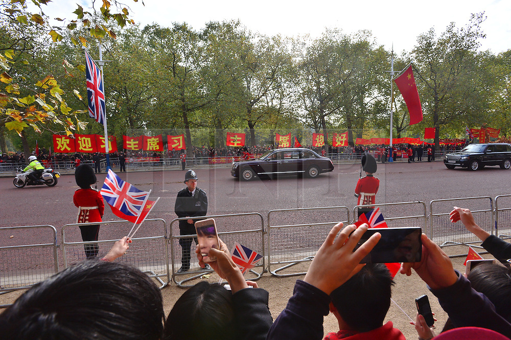 © Licensed to London News Pictures. 20/10/2015. London UK. A car carrying Written Elizabeth II and Prince Philip makes its way along the Mall to Horseguards as Chinese President Xi Jinping starts day one of a four day State Visit to the United Kingdom. Photo credit: Ben Cawthra/LNP