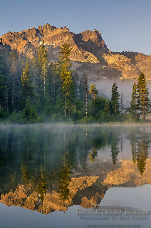 The Sierra Buttes reflection on a misty morning near Sardine Lakes, Tahoe National Forest, Sierra County, California