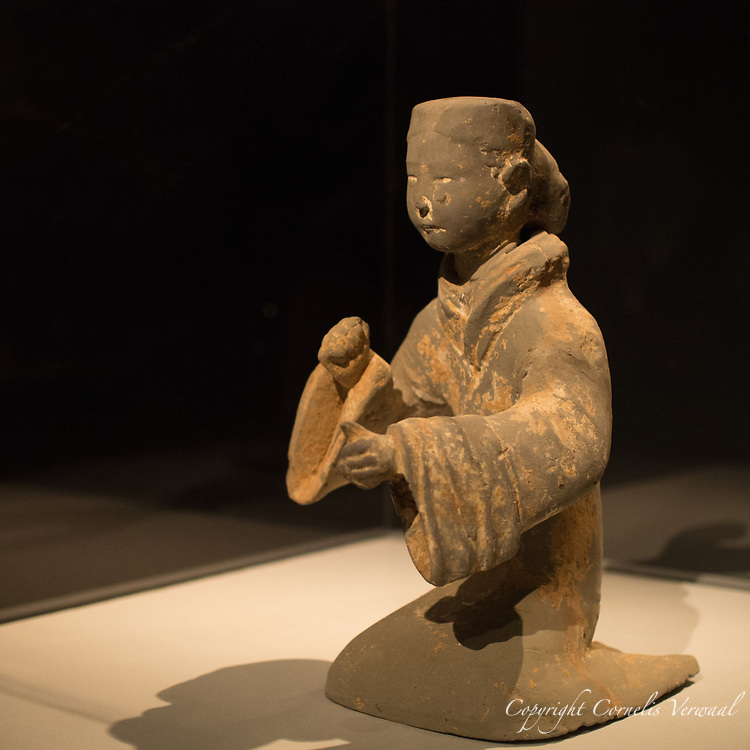 """""""Female Musician Playing Chimes"""" - Western Han dynasty (206 B.C.-A.D. 9)   This very animated and life-like girl was one of my favorite figures on display at the Metropolitan Museum of art's exhibit """"The Age of Empires"""""""