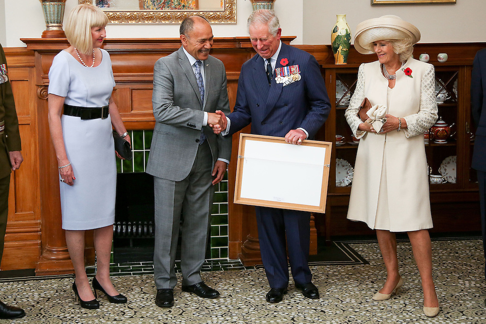 Governor-General Sir Jerry Mateparae presents Prince Charles, Prince of Wales with his new Military Warrants while Lady Janine Mateparae and Camilla, Duchess of Cornwall looks on at Government House, Wellington, New Zealand, Wednesday, November 04, 2015. Credit:SNPA / Getty, Hagen Hopkins **POOL**