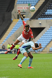 Bristol City's Marlon Pack battles for the high ball with Coventry City's Jordan Clarke  - Photo mandatory by-line: Joe Meredith/JMP - Mobile: 07966 386802 - 18/10/2014 - SPORT - Football - Coventry - Ricoh Arena - Bristol City v Coventry City - Sky Bet League One