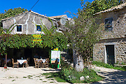 Restaurant taverna in centre town square of oldest town in Corfu -ancient village of Old Perithia - Palea Perithea, Greece