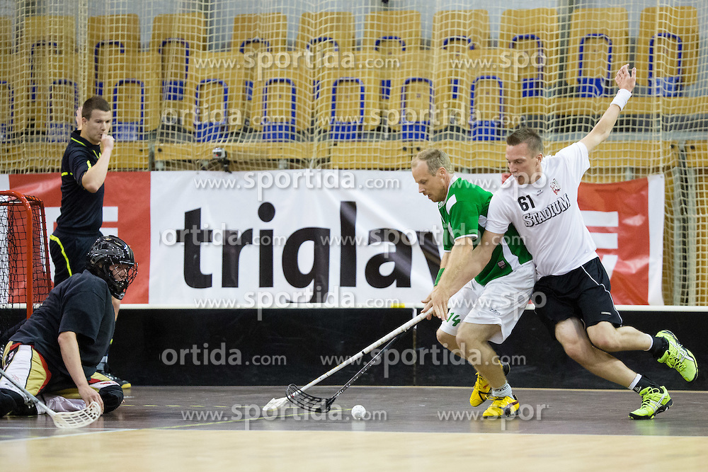 Blaz Srpan of FBK Olimpija vs Hannu Punta of Downtown Tigers during match for fifth place between Downtown Tigers (FIN) and FBK Olimpija (SLO)  in Floorball Slo Open 2012, on August 26, 2012 in Ljubljana, Slovenia.  (Photo by Matic Klansek Velej / Sportida.com)