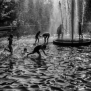 The temperatures in NYC reached a record of 104°F (40°C) and this was one of the ways to stay cool. Washington Square Park, New York City.