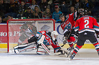KELOWNA, CANADA - DECEMBER 8:  Jordon Cooke #30 of the Kelowna Rockets makes a save against the Prince George Cougars at the Kelowna Rockets on December 8, 2012 at Prospera Place in Kelowna, British Columbia, Canada (Photo by Marissa Baecker/Shoot the Breeze) *** Local Caption ***