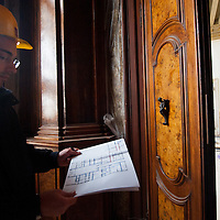 A member of the Claudio Rebeschini team  inspects restoration works at  at Palazzo Coccina Tiepolo Papadopoli. Several major restoration works are being carried out in this period in Venice, the go to a complete refurbishment of the famous Gritti Palace Hotel, to transformation into a luxury VIP 7 stars hotel of XV century Palazzo Papadopoli to the restoration of the Church of the Gesuiti