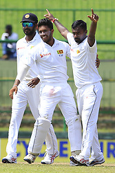 August 12, 2017 - Colombo, Sri Lanka - Sri Lankan cricketer Malinda Pushpakumara (R) celebrates with his team mates after taking a wicket   during the 1st Day's play in the 3rd Test match between Sri Lanka and India at the Pallekele International cricket stadium, Kandy, Sri Lanka on Saturday 12 August 2017. (Credit Image: © Tharaka Basnayaka/NurPhoto via ZUMA Press)