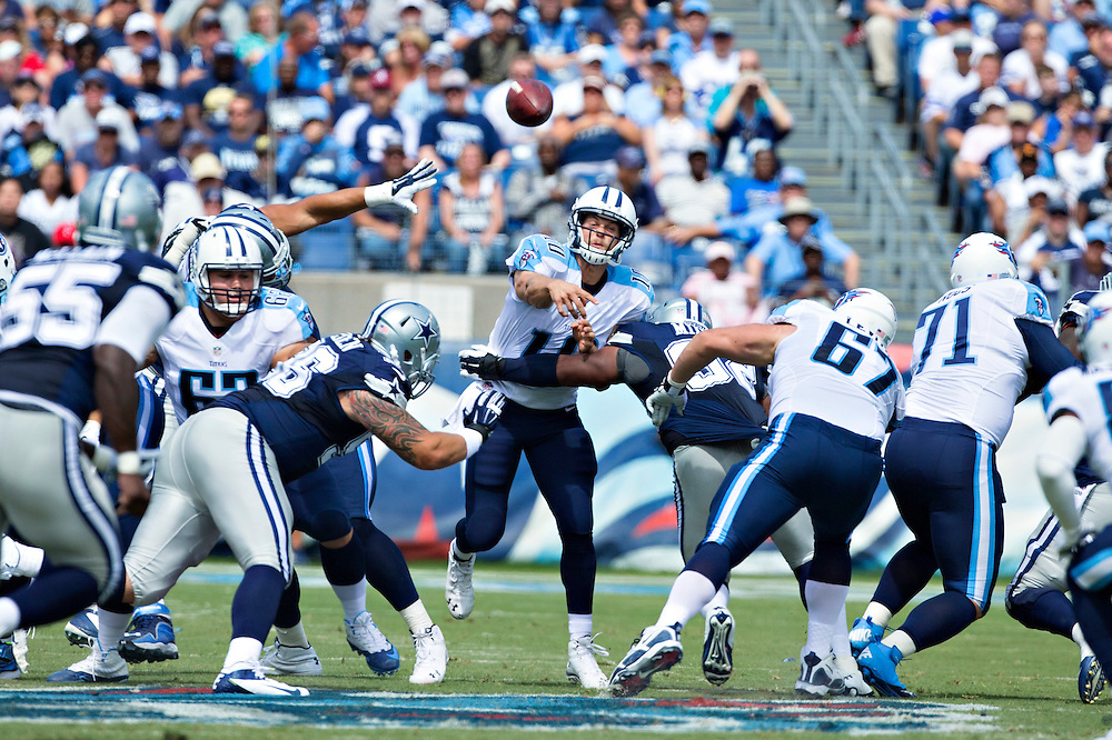 NASHVILLE, TN - SEPTEMBER 14:  Jake Locker #10 of the Tennessee Titans is hit while throwing a pass by Jeremy Mincey #92 of the Dallas Cowboys at LP Field on September 14, 2014 in Nashville, Tennessee.  (Photo by Wesley Hitt/Getty Images) *** Local Caption *** Jake Locker; Jeremy Mincey