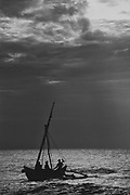 Dawn on the East Coast in 1992, July.<br />A fishing boat has just set to sea.<br />Thirukovil