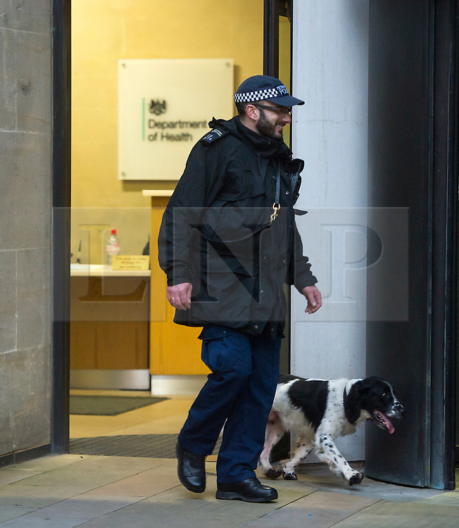 © Licensed to London News Pictures. 31/12/2015. London, UK. Police sniffer dogs searching The Department of Health in Westminster, central London toady (Thurs) as security in the capital is heightened ahead of New Year celebrations this evening.  Photo credit: Ben Cawthra/LNP