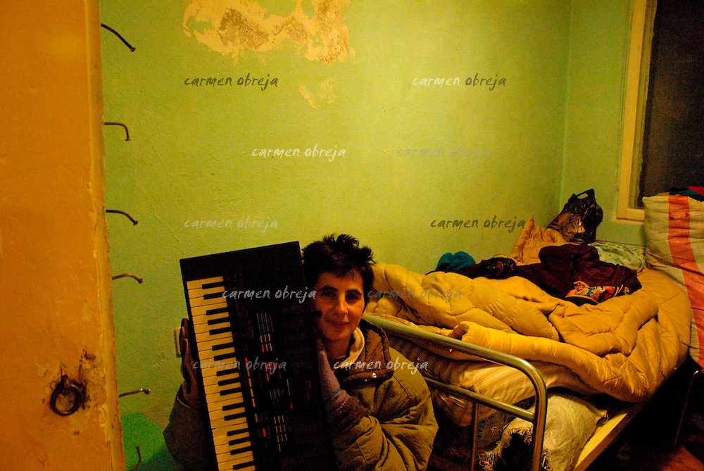 Mioara,31 had to leave public orphanage at 18 and felt helpless. .The same year she was brought at Provita. .A foreign volunteer gave her the organ as a gift..(april 2008)