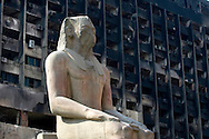 A pharaonic statue sits outside of the Egyptian Antiquities Museum which sits next to the burned remains of the former NDP ruling party headquarters in Cairo, on October 3, 2011.  The NDP was set ablaze during the revolution. Egypt's tourism industry has taken a hit from recent violence in Cairo which came at the start of Egypt's tourism season.  Ann Hermes/© The Christian Science Monitor 2011