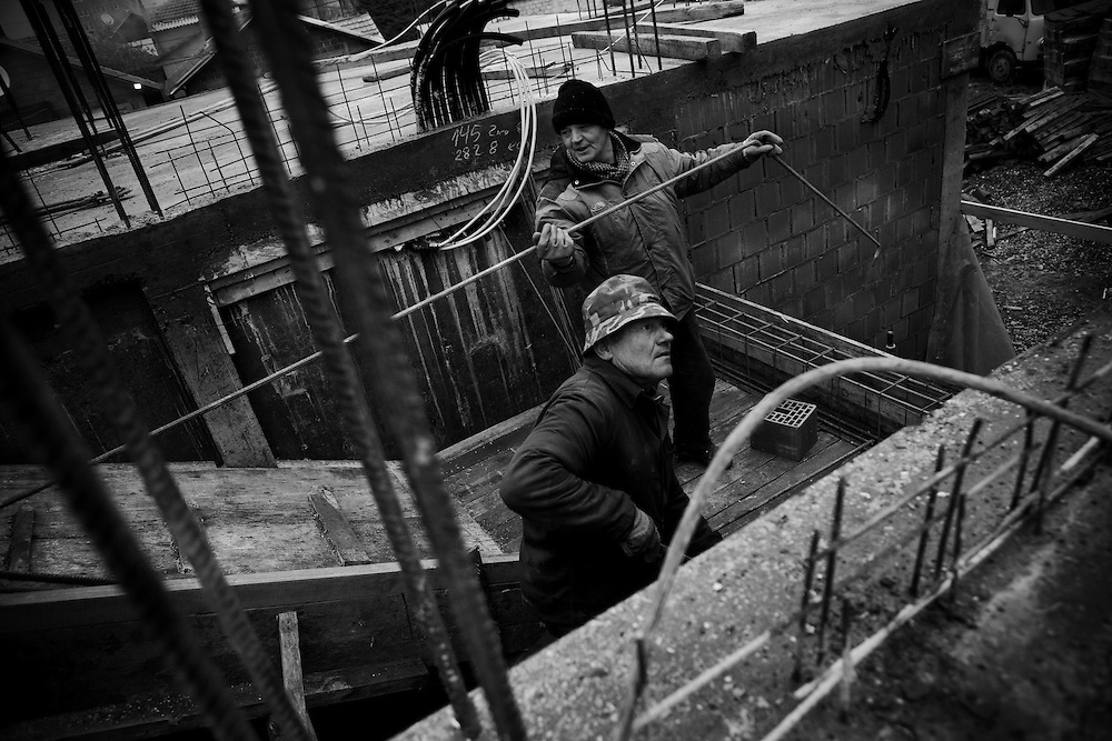 Serbian construction workers building apartment blocks in Serbian dominated north Mitrovica, Kosovo, on Nov. 30, 2007. In anticipation of a declaration of Independence from Pristina, Belgrade is seeking to consolidate the Serbian presence in the territory.