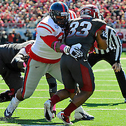 Mississippi defensive tackle Gilbert Pena (99) tackles Arkansas running back Dennis Johnson (33) during an NCAA college football game in Little Rock, Ark., Saturday, Oct. 27, 2012. (Photo/Thomas Graning)