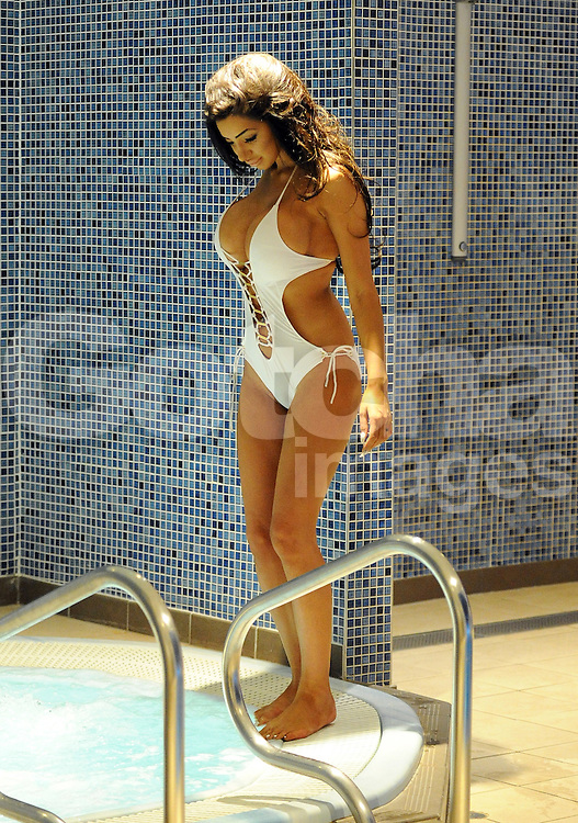 (EXCLUSIVE PICTURES) Chloe Khan aka Chloe Mafia wearing a skimpy swimming costume, takes time out at a spa after the breakup with millionaire boyfriend John Grey. The playboy model looked in good spirits as she soaked in the jacuzzi. England. UK. 31/08/2015<br /> BYLINE MUST READ : GOTCHAIMAGES.COM<br /> <br /> Copyright by &copy; Gotcha Images Ltd. All rights reserved.<br /> Usage of this image is conditional upon the acceptance <br /> of Gotcha Images Ltd, terms and conditions available at<br /> www.gotchaimages.com