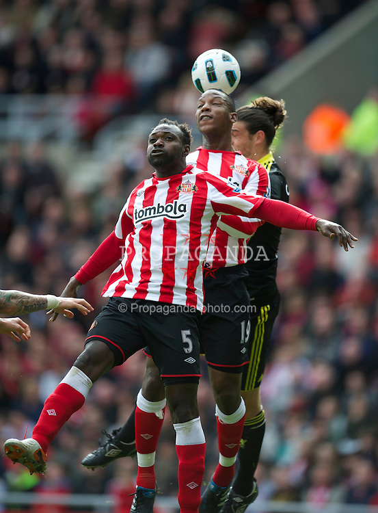 SUNDERLAND, ENGLAND - Sunday, March 20, 2011: Liverpool's Andy Carroll is out jumped by Sunderland's John Mensah and captain Titus Bramble during the Premiership match at the Stadium of Light. (Photo by David Rawcliffe/Propaganda)